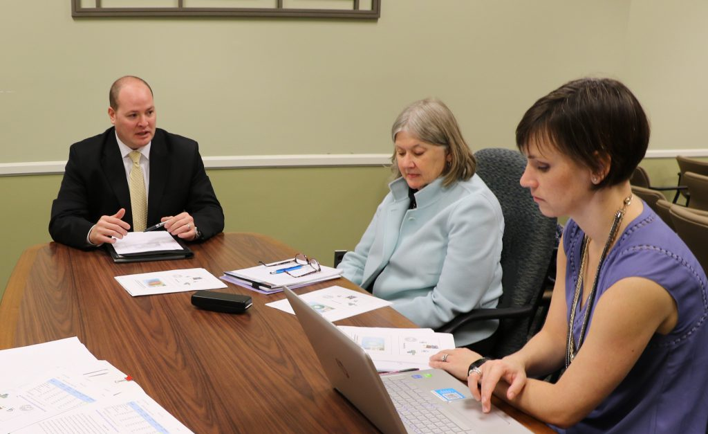 EdD candidate reviews ELP with faculty